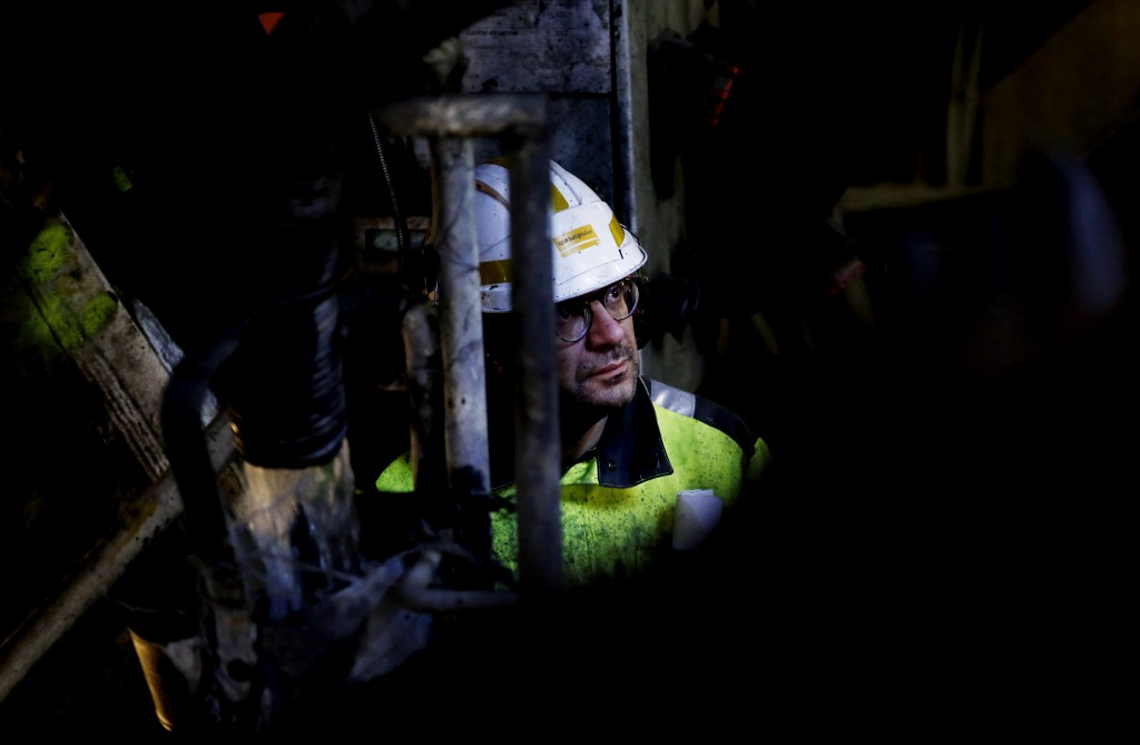 """A man works on a 140-meter-long rock-eating machine dubbed """"Federica"""" in a Turin-Lyon high-speed rail tunnel (TAV) in Saint Martin La Porte, France, T..."""