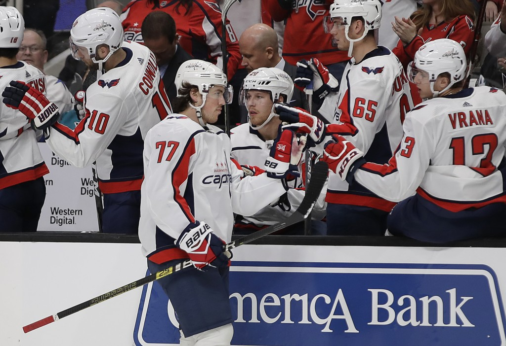Washington Capitals' T.J. Oshie (77) is congratulated after scoring a goal against the San Jose Sharks in the first period of an NHL hockey game Thurs...