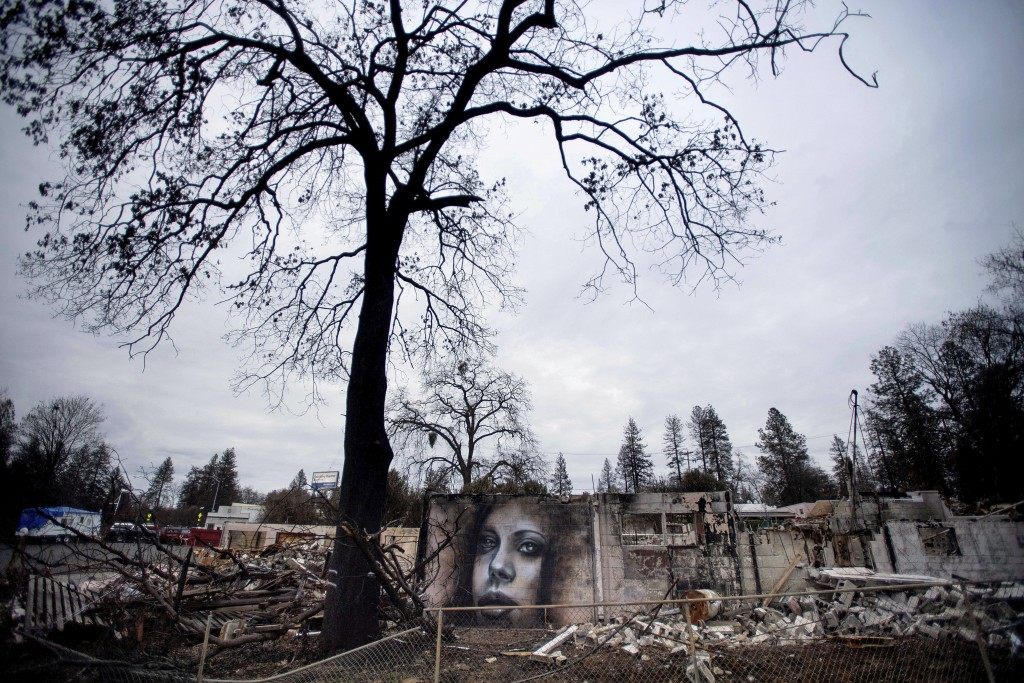 A mural by artist Shane Grammer adorns the wall of a building leveled by the Camp Fire in Paradise, Calif., on Friday, Feb. 8, 2019. Grammer says he p...
