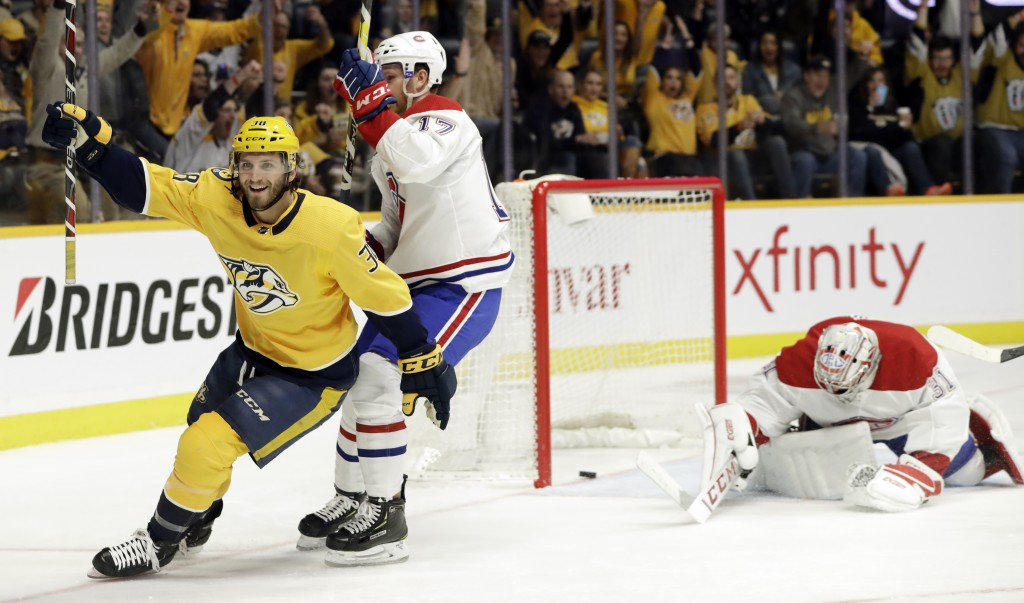Nashville Predators right wing Ryan Hartman (38) celebrates after scoring a goal against Montreal Canadiens goaltender Carey Price, right, in the seco...