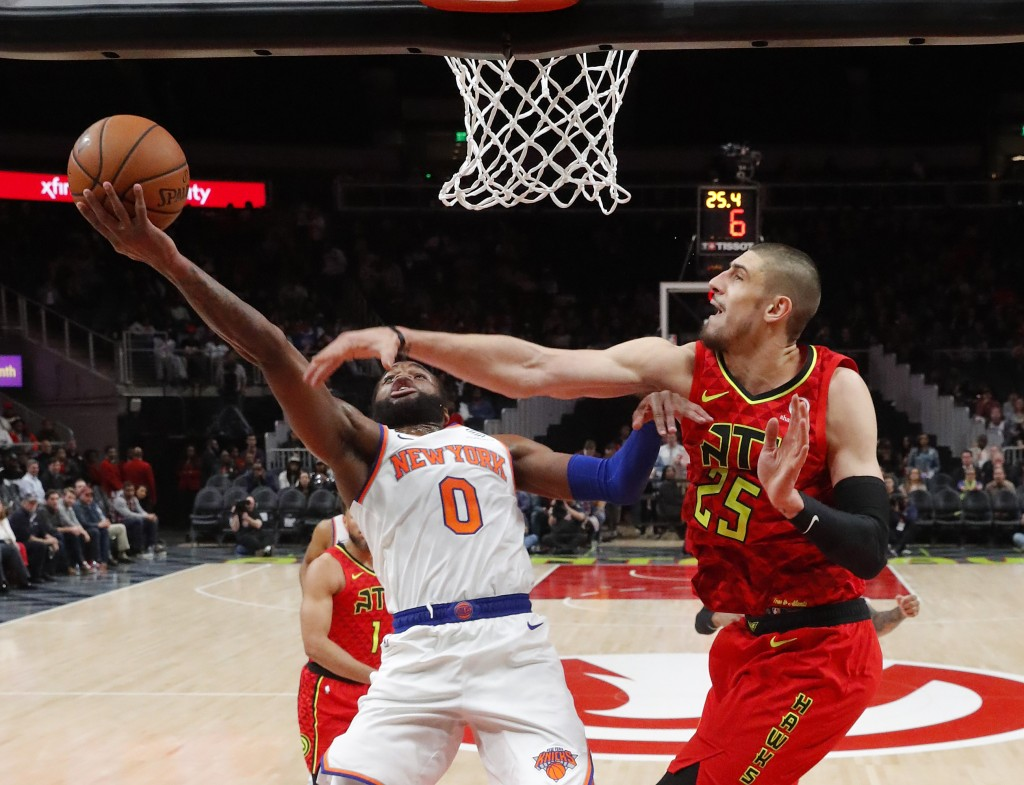 New York Knicks guard Kadeem Allen (0) gos in for a basket as Atlanta Hawks center Alex Len (25) defends during the first half of an NBA basketball ga...