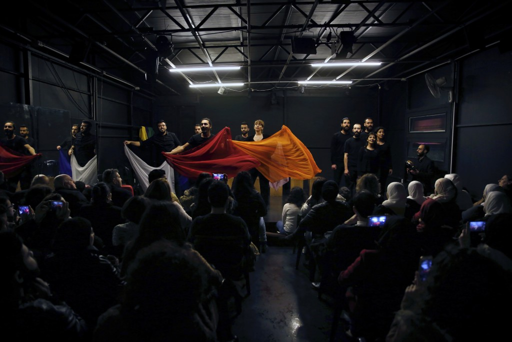 In this Friday, Feb. 8, 2019 photo, a team of Syrian actors take part in a playback theater at the end of a three-month training session, in Beirut, L