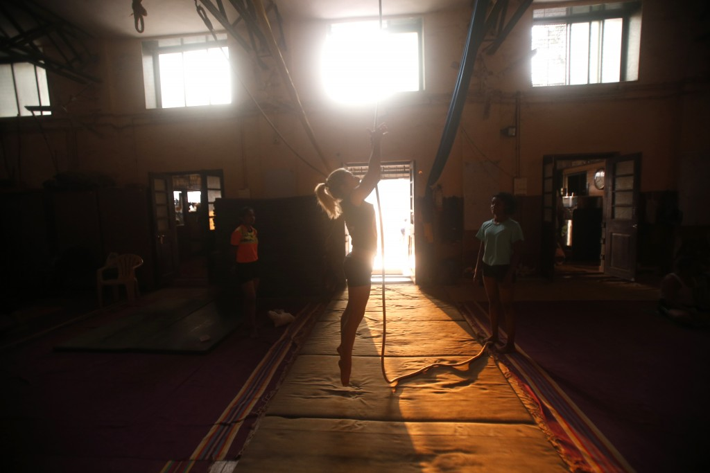 In this Feb. 5, 2019, photo, Delia Ceruti, 36, an aerialist and physical performer from Italy, performs a rope version of mallakhamb, during a trainin...