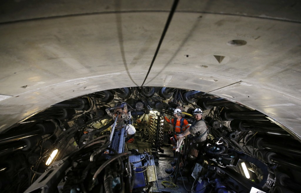 Engineers work on a 140-meter-long rock-eating machine dubbed 'Federica' in a Turin-Lyon high-speed rail tunnel (TAV) in Saint Martin La Porte, France...