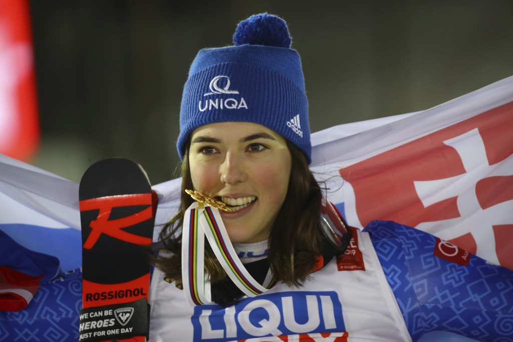Slovakia's Petra Vlhova bites her gold medal of the women's giant slalom, at the alpine ski World Championships in Are, Sweden, Thursday, Feb. 14, 201...