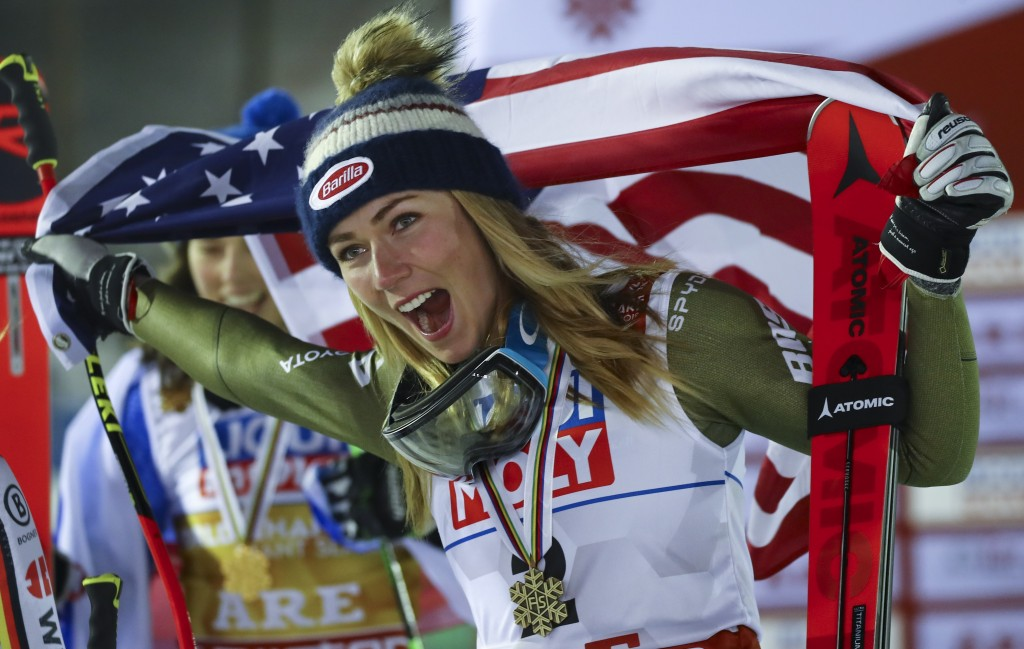 United States' Mikaela Shiffrin celebrates after winning g the bronze medal in the women's giant slalom, at the alpine ski World Championships in Are,...