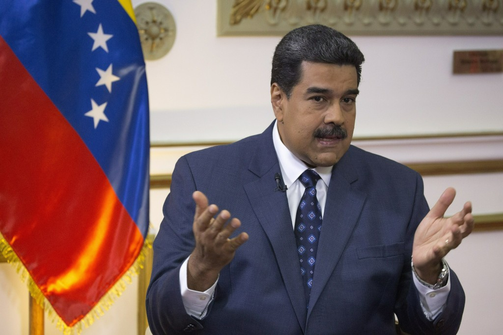 Venezuela's President Nicolas Maduro speaks during an interview with The Associated Press at Miraflores presidential palace in Caracas, Venezuela, Thu...