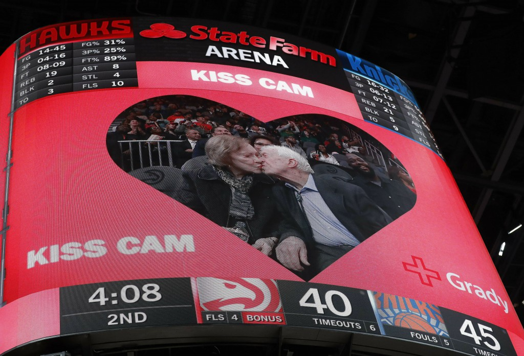 """Former President Jimmy Carter kisses his wife, Rosalynn, after the two were spotted by the 'kiss cam"""" during the first half of an NBA basketball game ..."""