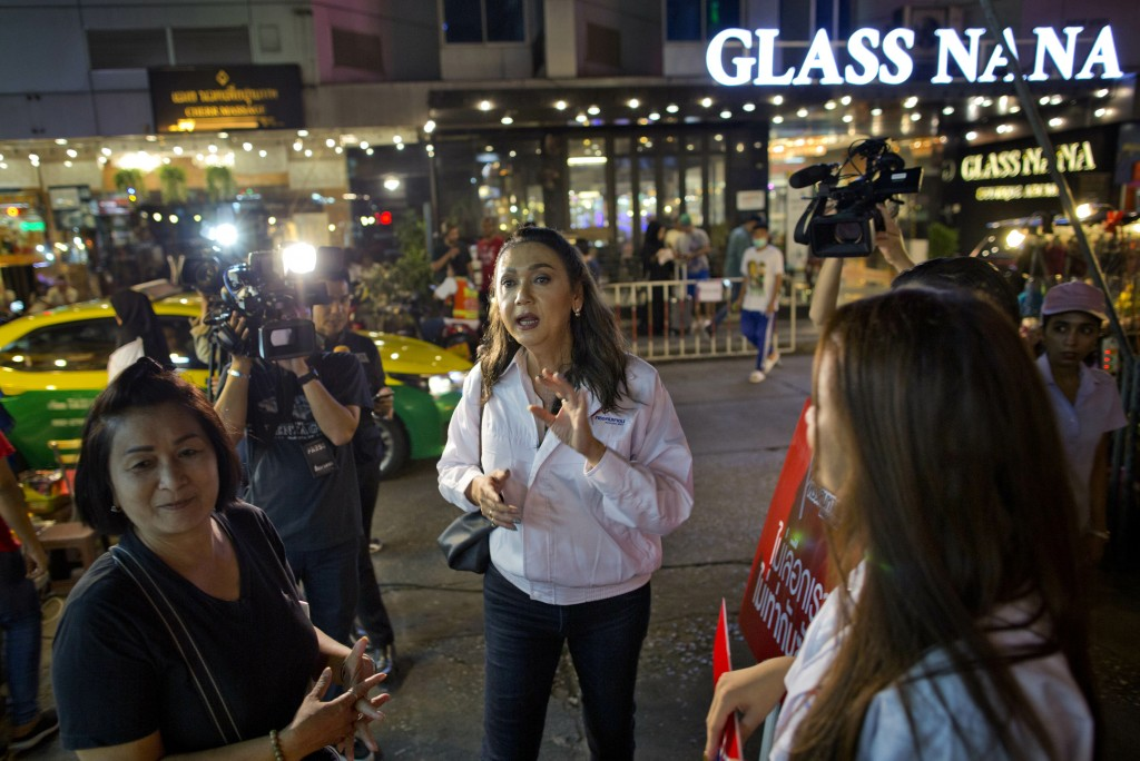 In this Wednesday, Feb. 13, 2019, photo, Pauline Ngarmpring center, a transgender person and a prime minister candidate of the Mahachon party for the ...
