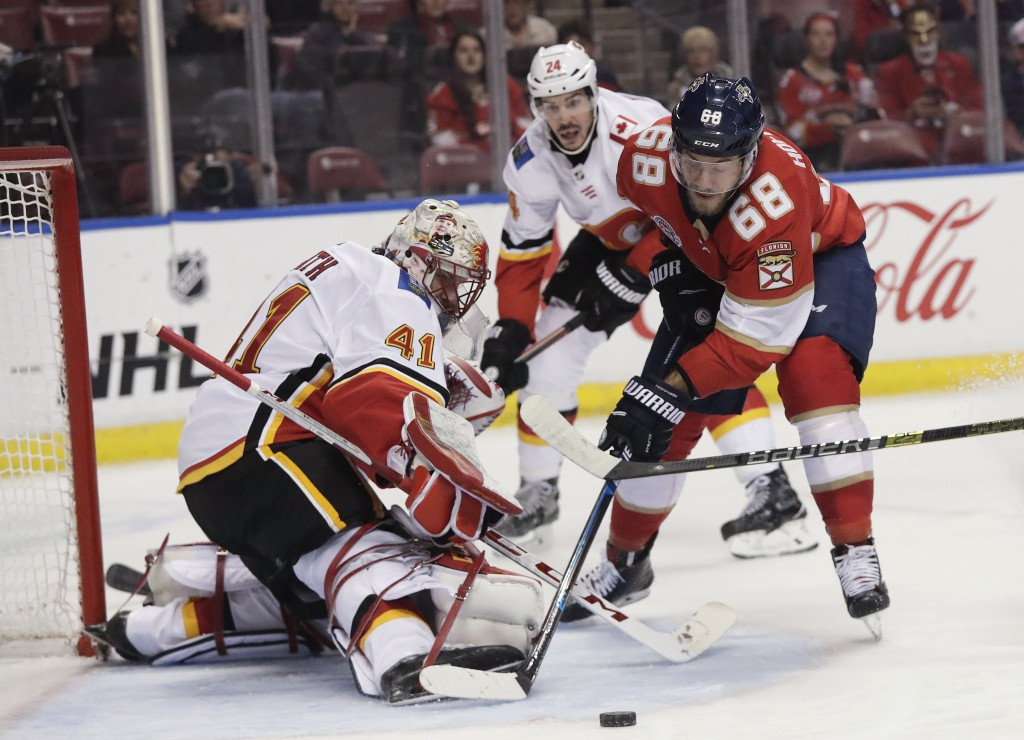 Florida Panthers left wing Mike Hoffman tries to score against as Calgary Flames goaltender Mike Smith blocks the puck during the first period of an N...