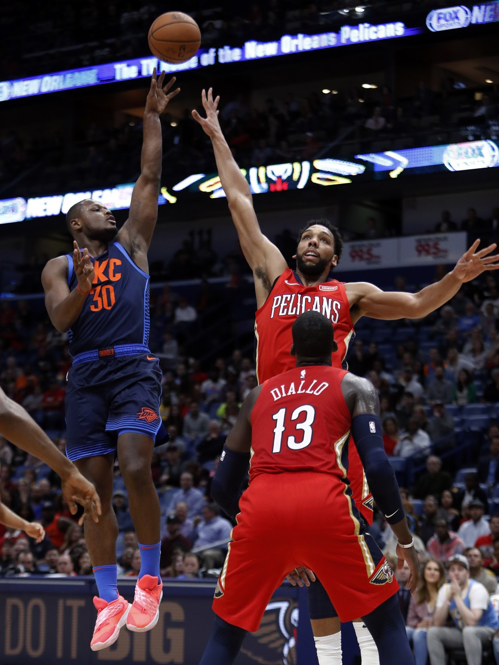 Oklahoma City Thunder guard Deonte Burton (30) shoots over New Orleans Pelicans center Jahlil Okafor, right rear, during the first half of an NBA bask...