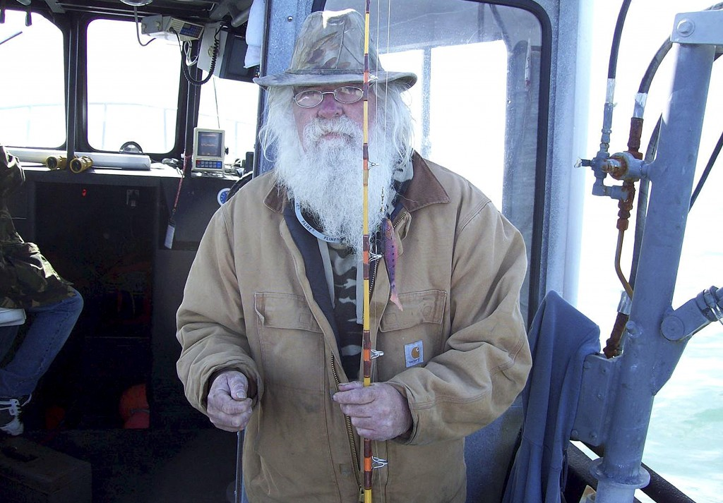 This 2008 photo provided by Chardonnay Telly shows Richard Brown fishing in Fort Bragg, Calif. Flames overtook 74-year-old Richard Brown's beloved log...