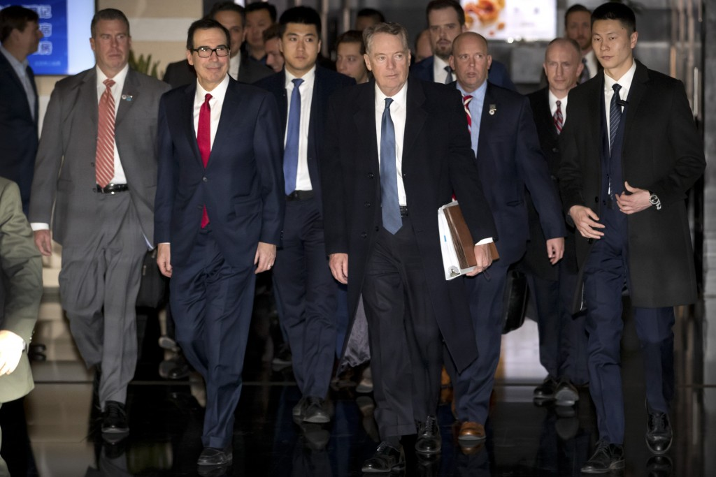 U.S. Treasury Secretary Steven Mnuchin, second from left, and U.S. Trade Representative Robert Lighthizer, fourth from left, walk together as they lea...