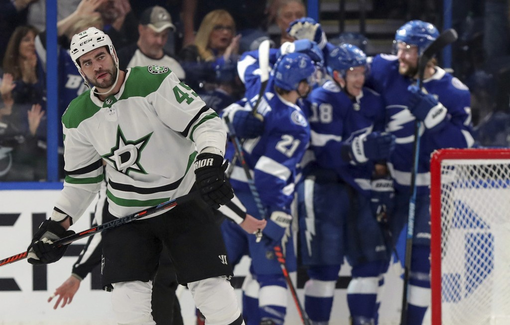 Dallas Stars' Roman Polak, of Czech Republic, skates away as Tampa Bay Lightning players celebrate a goal during the first period of an NHL hockey gam...