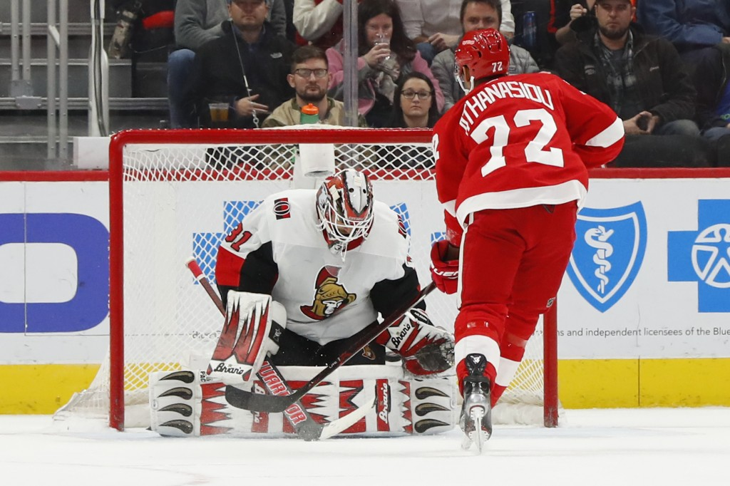 Detroit Red Wings center Andreas Athanasiou (72) scores on Ottawa Senators goaltender Anders Nilsson (31) on a penalty shot in the first period of an ...