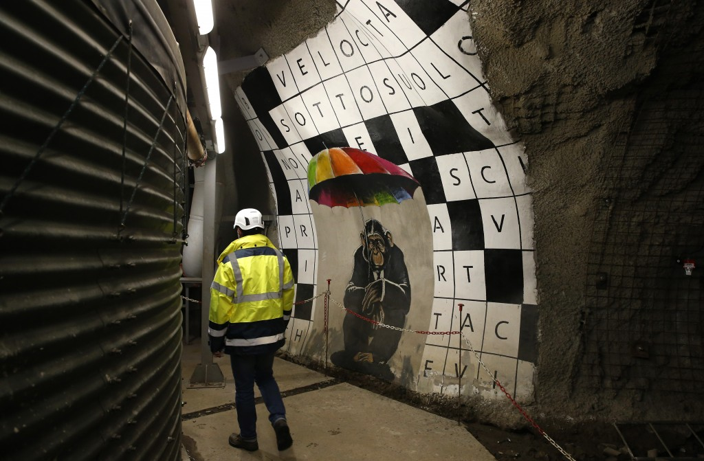 A man walks in a test and exploring tunnel for a Turin-Lyon high-speed rail (TAV) in Chiomonte, Italy, Tuesday, Feb. 12, 2019. The TAV project is part...