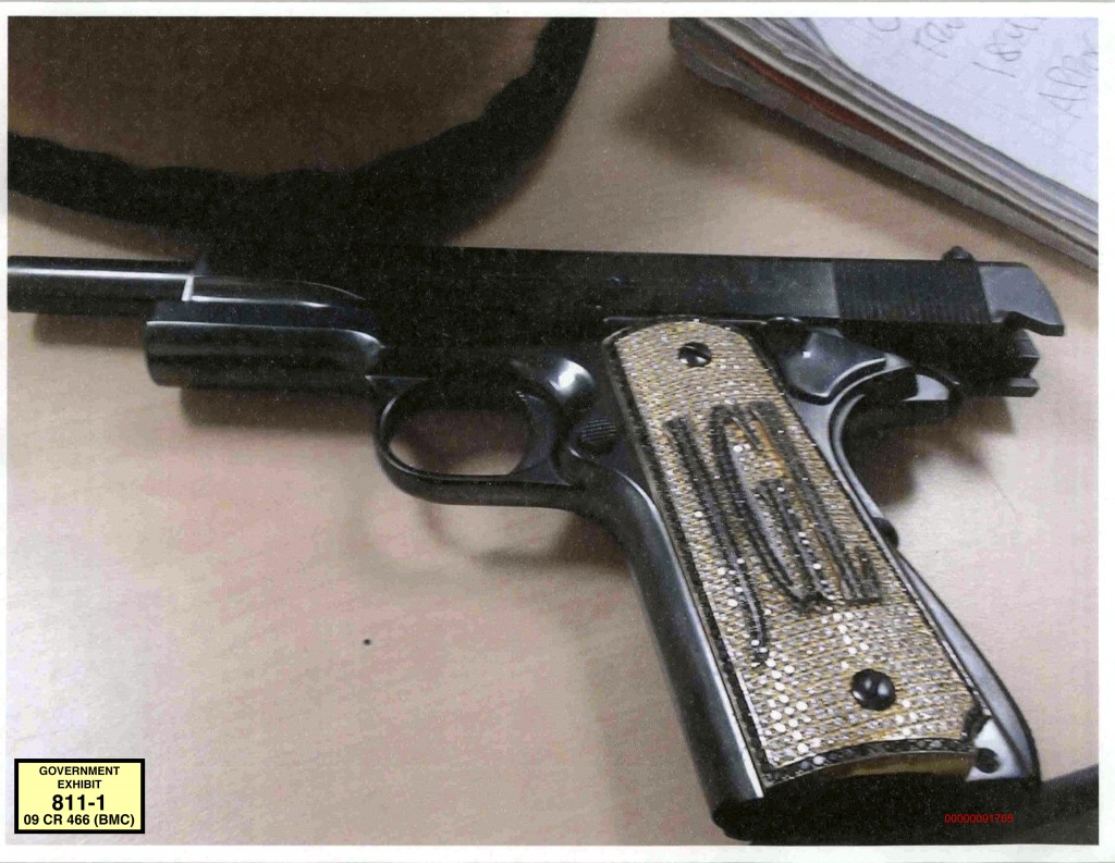 FILE - This undated file photo provided by the U.S. Attorney's Office shows a diamond-encrusted pistol that a government witness said belonged to infa...