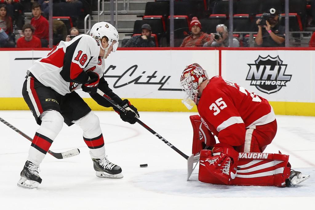 Detroit Red Wings goaltender Jimmy Howard (35) stops a Ottawa Senators left wing Ryan Dzingel (18) shot in the third period of an NHL hockey game Thur...