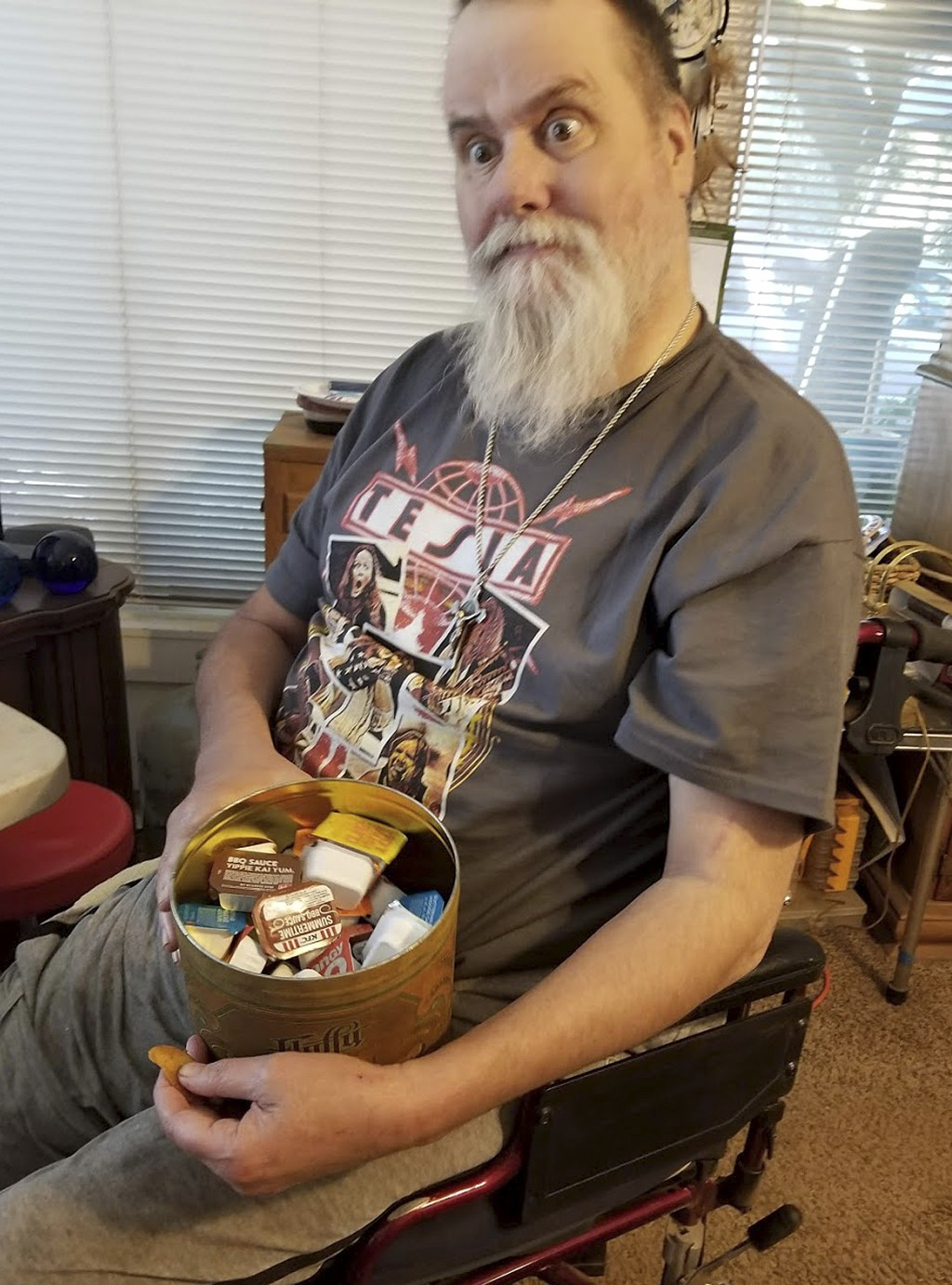 This undated photo provided by Cindy MacDonald shows Andrew Downer joking as he poses for photos holding packets of condiments. Downer, 54, had lost h...