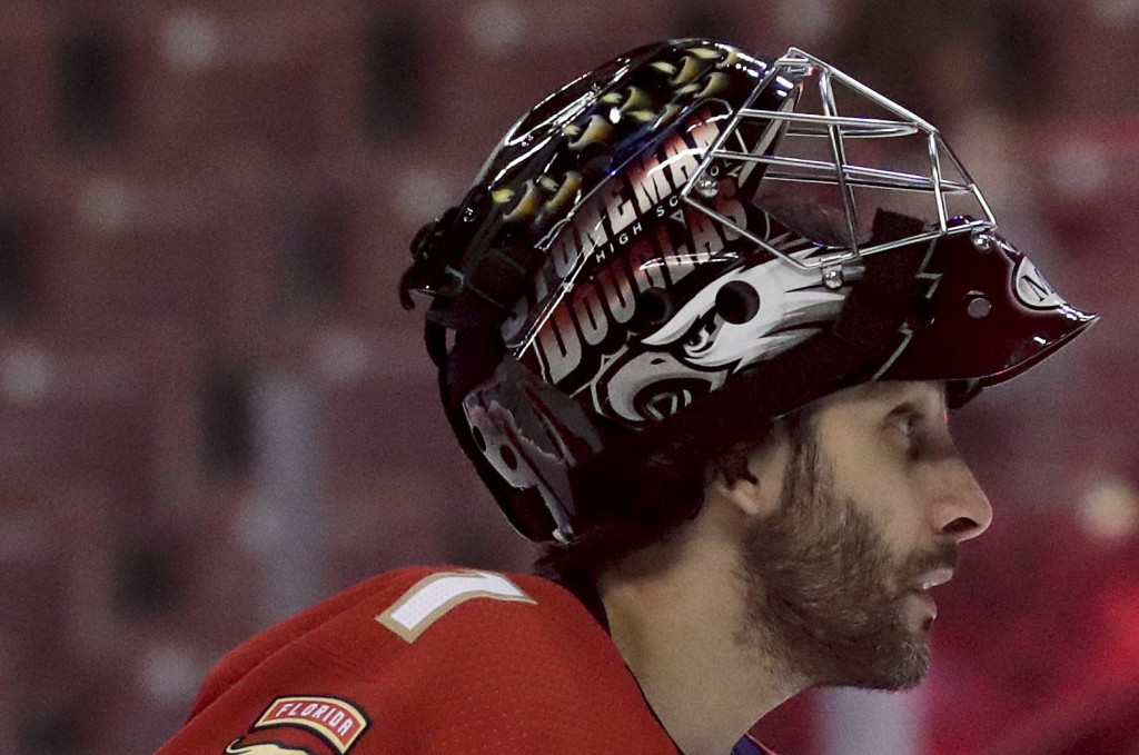Florida Panthers goaltender Roberto Luongo wears a Marjory Stoneman Douglas High School logo on his helmet during practice before an NHL hockey game T...