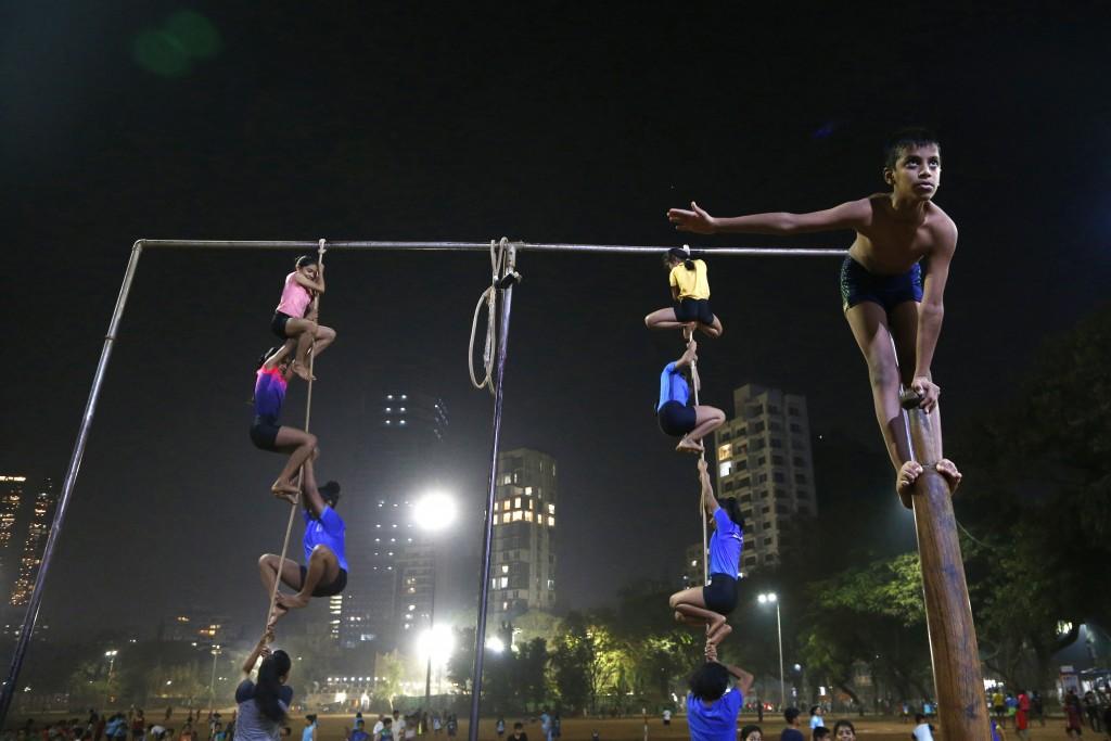 In this Feb. 4, 2019, photo, players perform on a mallakhamb pole and rope at the Shree Samartha Vyayam Mandir at Shivaji Park in Mumbai, India. The w...