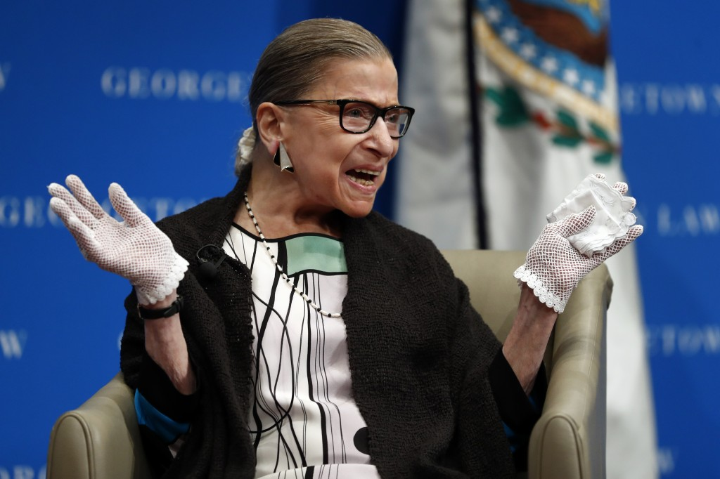 In this Sept. 20, 2017 photo, U.S. Supreme Court Justice Ruth Bader Ginsburg reacts to applause as she is introduced by William Treanor, Dean and Exec...
