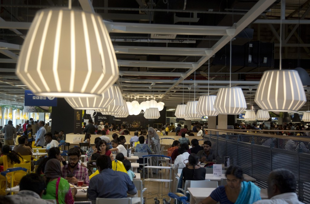 FILE- In this Aug. 9, 2018, file photo, customers sit at the restaurant inside Ikea's's first store in India as it opened in Hyderabad, India. In Hyde...