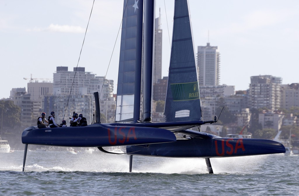 The F50 catamaran of the USA team lifts out of the water during their SailGP race on the harbor in Sydney, Friday, Feb. 15, 2019. A fleet of six super...