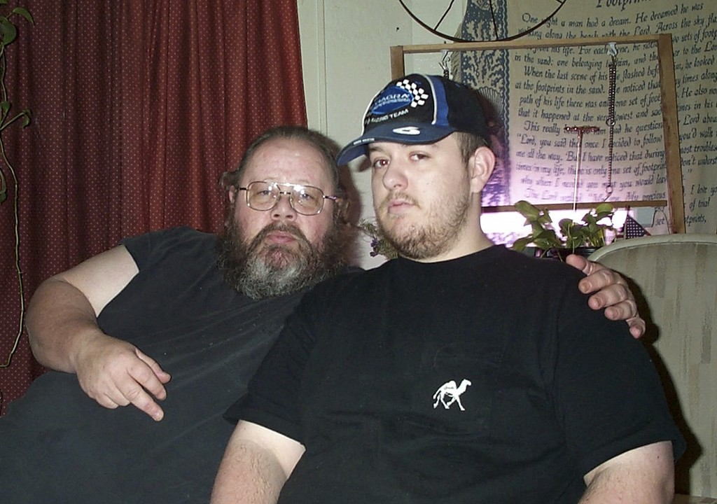 This 2003 photo provided by James Burt shows his brother Andrew Burt, right, with their father, Daniel James Burt, in Oklahoma. Andrew Burt, was found...