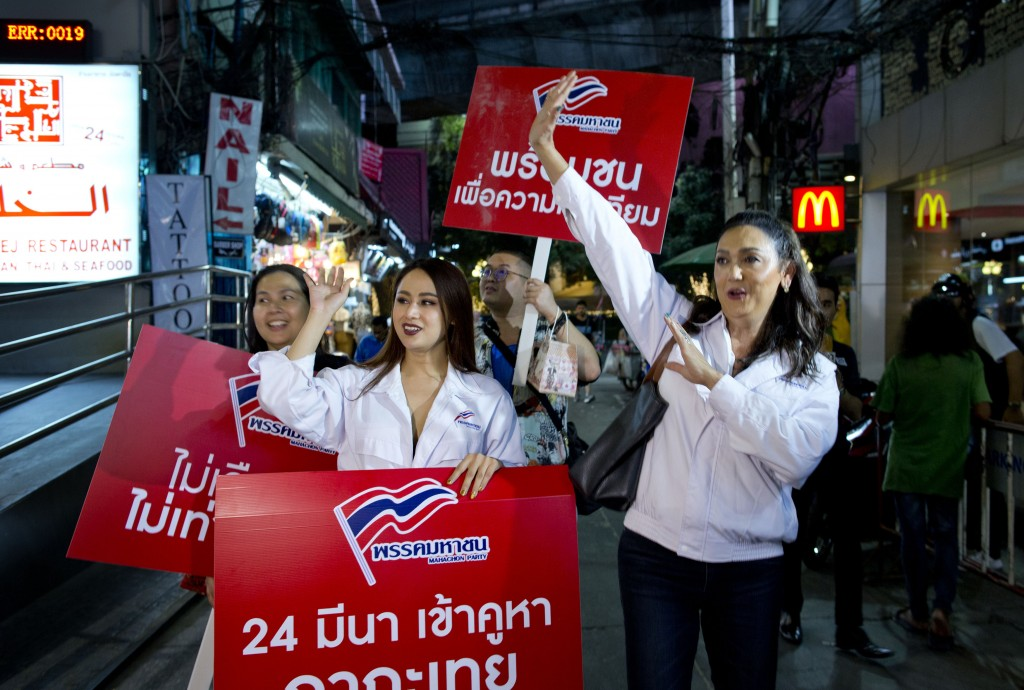 In this Wednesday, Feb. 13, 2019, photo, Pauline Ngarmpring, right, a transgender person and a prime minister candidate, and Namklenginarin, center, a...