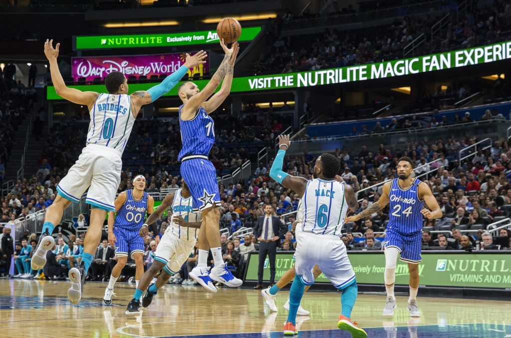 Orlando Magic guard Evan Fournier (10) shoots against Charlotte Hornets forward Miles Bridges (0) during the first half of an NBA basketball game in O...