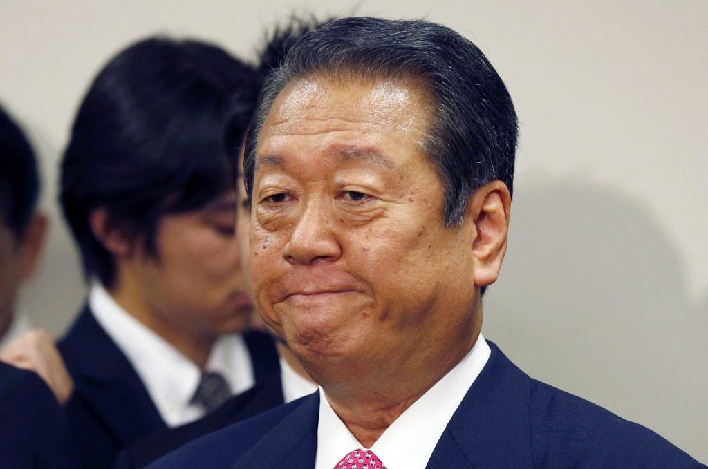 FILE - In this July 2, 2012, file photo, lower house lawmaker Ichiro Ozawa speaks during a press conference in Tokyo. Influential lawmaker Ozawa was c...