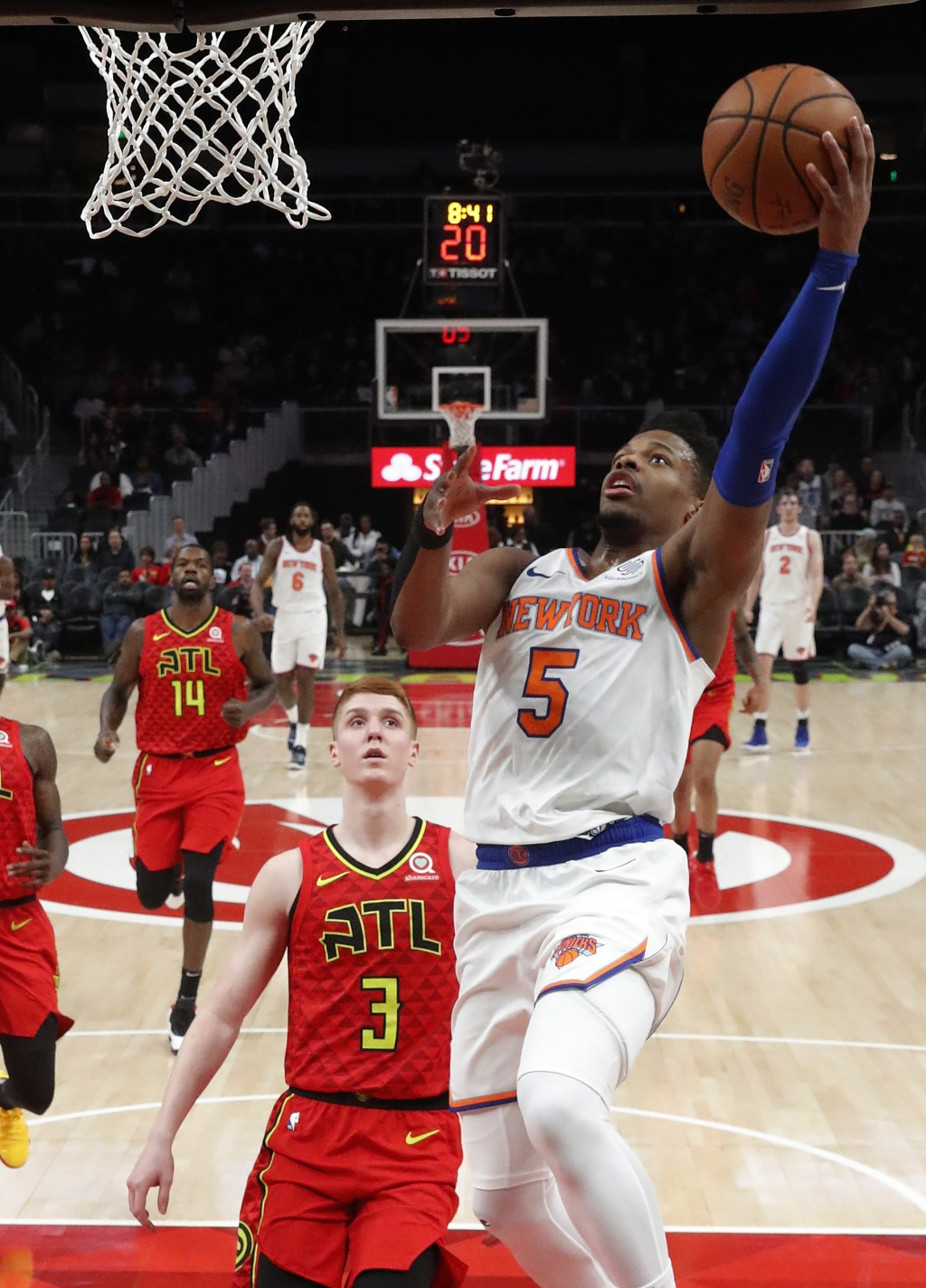New York Knicks guard Dennis Smith Jr. (5) goes in for a basket asA tlanta Hawks guard Kevin Huerter (3) watches during the first half of an NBA baske...