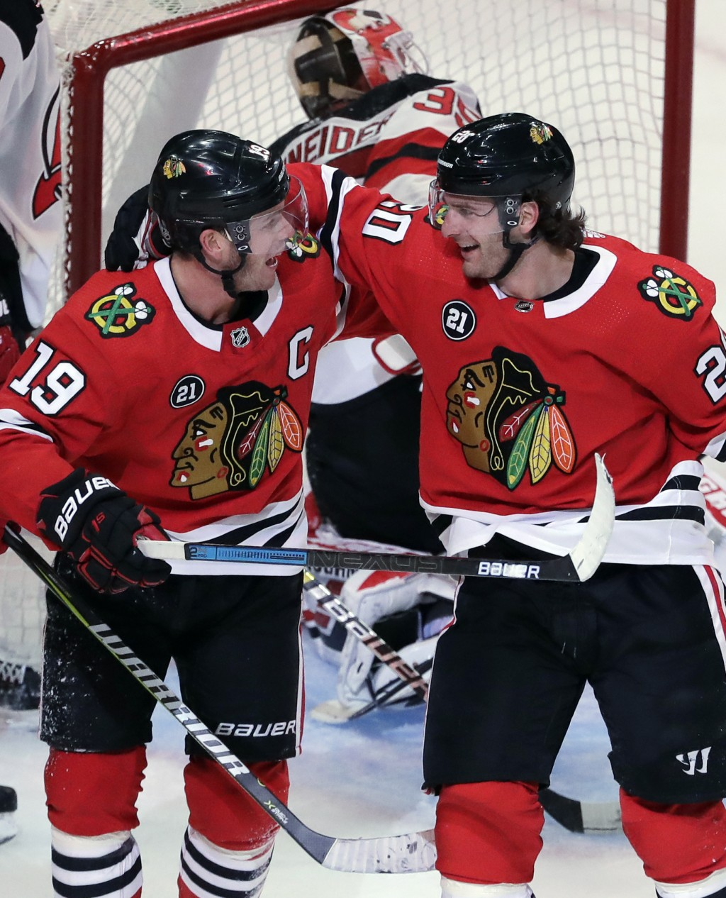 Chicago Blackhawks left wing Brandon Saad, right, smiles as he celebrates with center Jonathan Toews after scoring a goal against the New Jersey Devil...