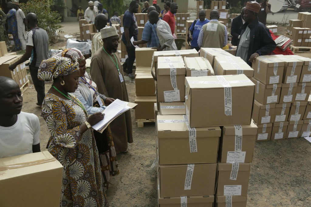 An electoral worker take stock of ballot papers to be transporters at the offices of the Independent National Electoral Commission in Yola, Nigeria, F