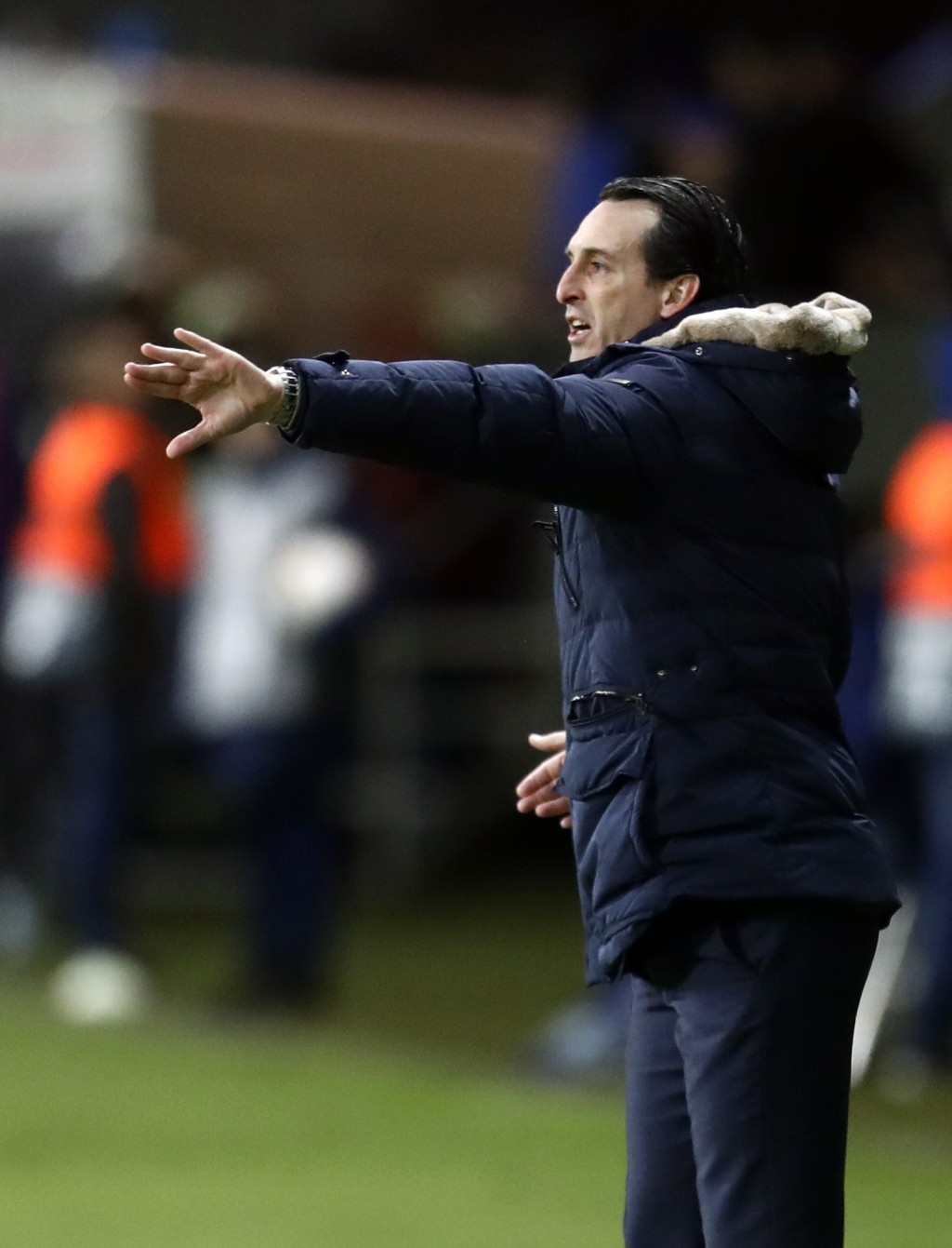 Arsenal coach Unai Emery, right, gives instructions to his players during the Europa League round of 32 first leg soccer match between Bate and Arsena...