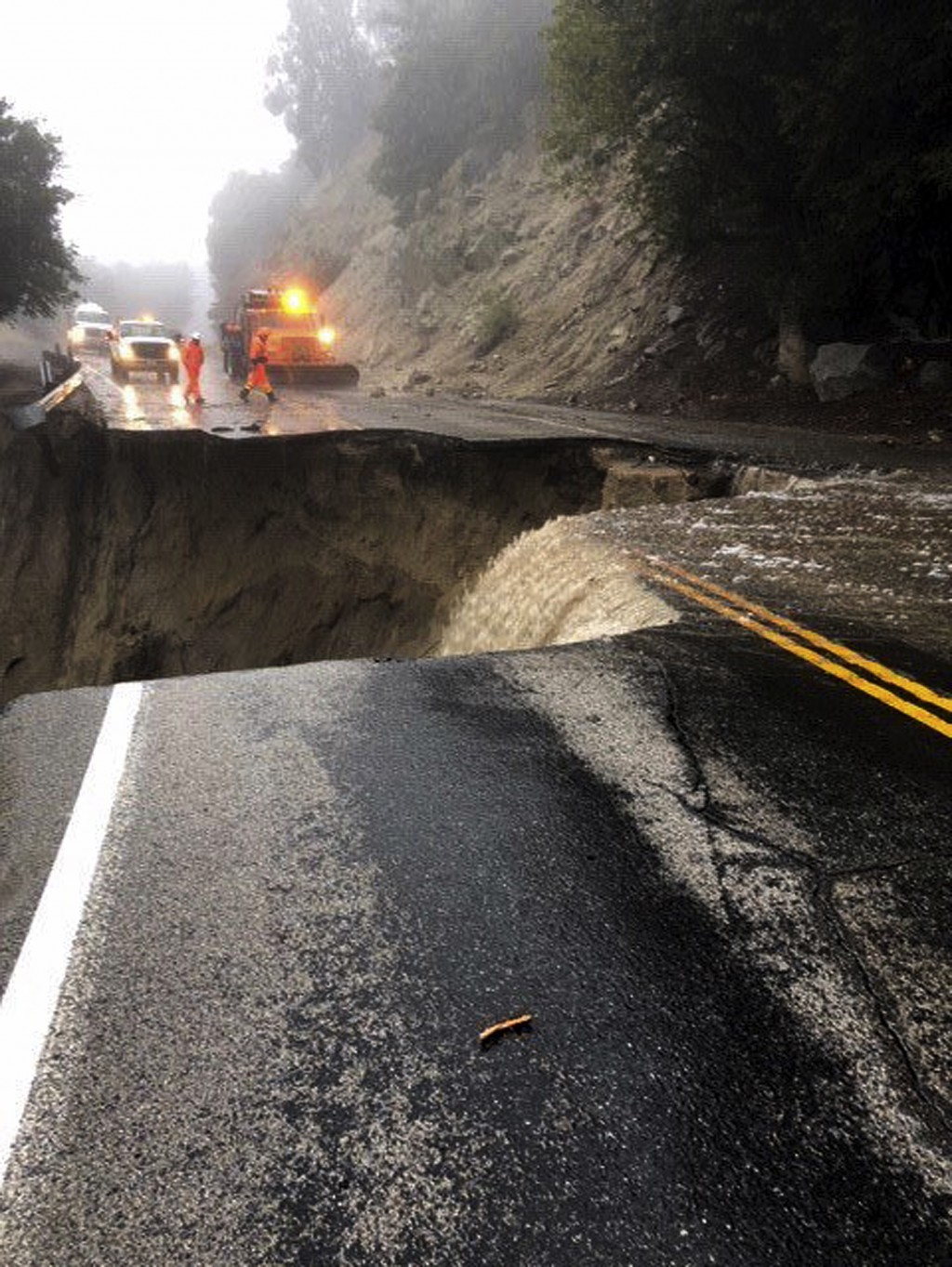 This photo released by Caltrans District 8 shows damage to Highway 243 near Lake Fulmor, Calif., Thursday, Feb. 14, 2019. Waves of heavy rain pounded ...