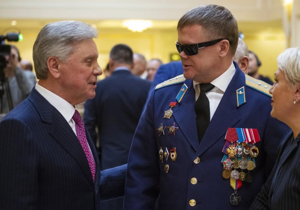 In this photo taken on Thursday, Feb. 14, 2019, Vladimir Vshivtsev, a veteran of the Soviet war in Afghanistan, right, and Gen. Col. Boris Gromov, for...