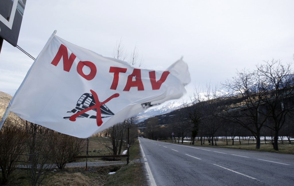 A flag flutters at the entrance of the No-TAV movement headquarters in Venaus, northern Italy, Tuesday, Feb. 12, 2019. The TAV project is part of a Eu...