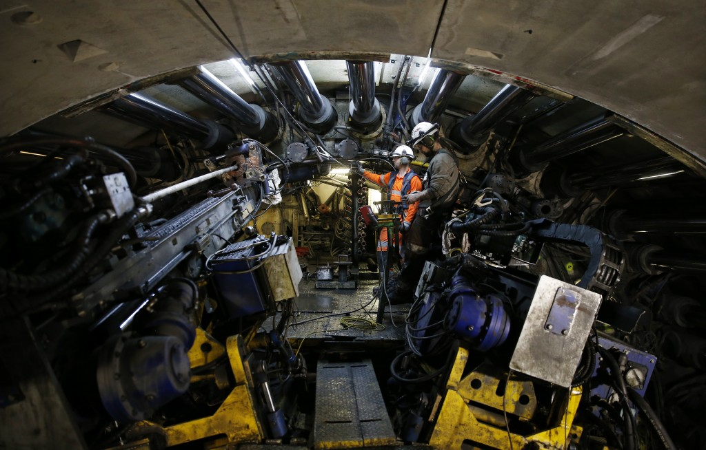 Engineers operate a 140-meter-long rock-eating machine dubbed 'Federica' in a Turin-Lyon high-speed rail tunnel (TAV) in Saint Martin La Porte, France...