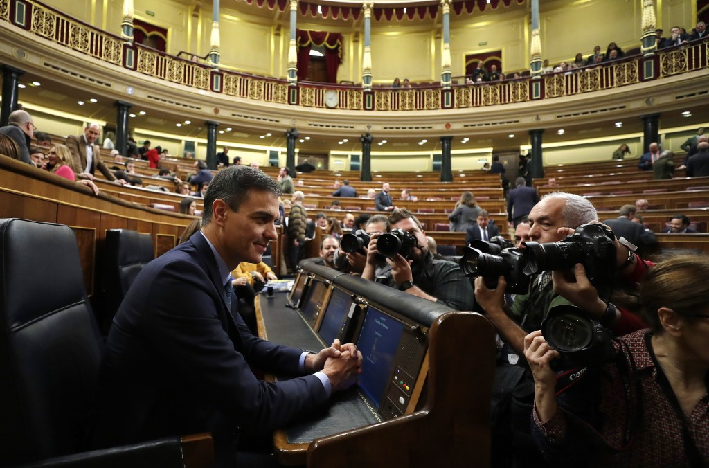 FILE - In this Wednesday, Feb. 13, 2019 file photo, Spain's Prime Minister Pedro Sanchez is photographed at the Spanish parliament in Madrid. Sanchez ...