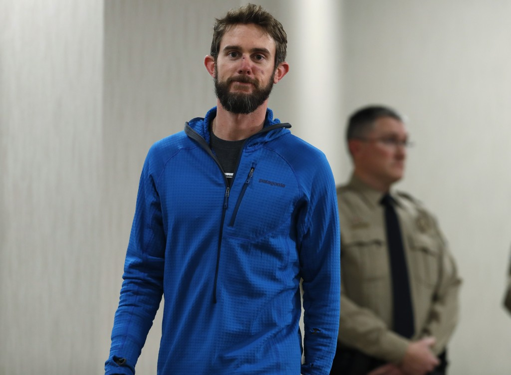 Travis Kauffman heads into a news conference Thursday, Feb. 14, 2019, in Fort Collins, Colo., about his encounter with a mountain lion while running a