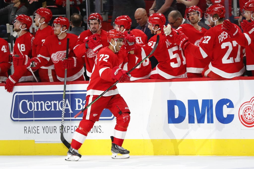 Detroit Red Wings center Andreas Athanasiou (72) celebrates his goal on a penalty shot in the first period of an NHL hockey game against the Ottawa Se...