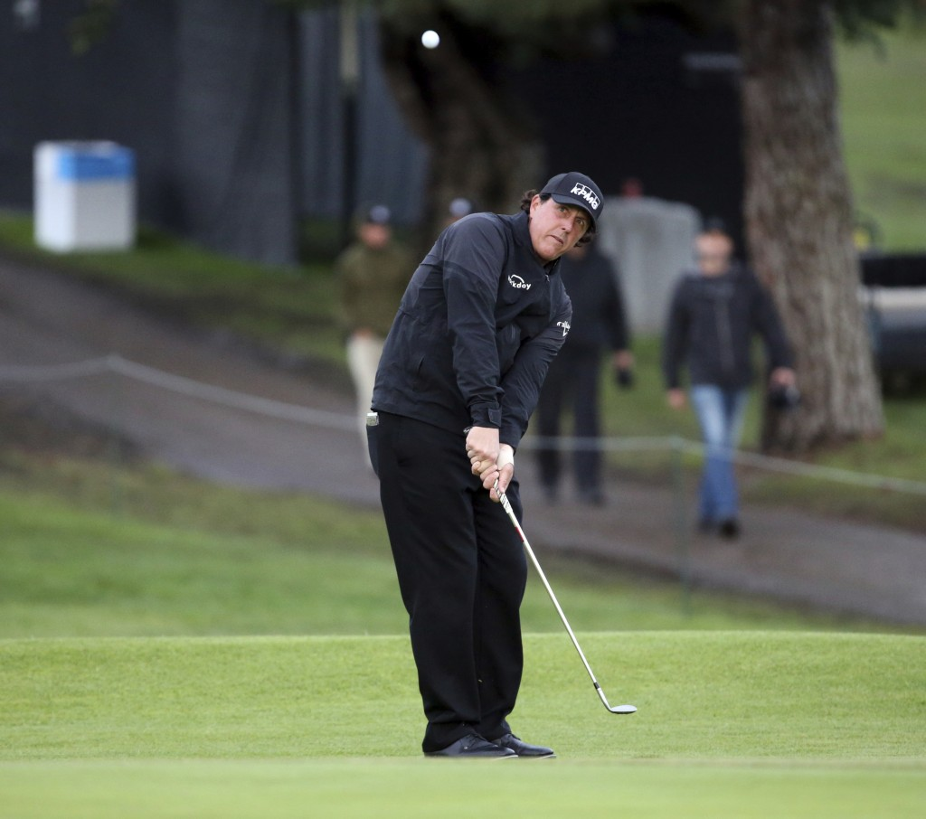 Phil Michelson hits to the second green during the first round of the Genesis Open golf tournament at Riviera Country Club in the Pacific Palisades ar...