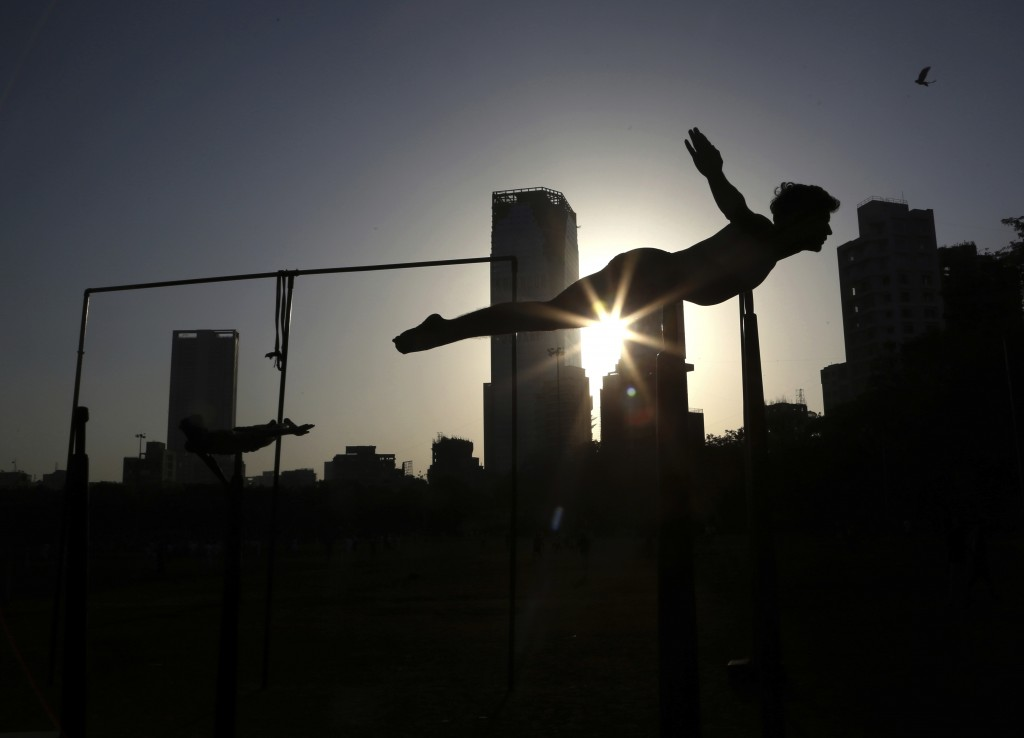 In this Feb. 7, 2019, photo, a player performs on a Mallakhamb pole during an early morning training session at Shivaji Park in Mumbai, India. The wor...