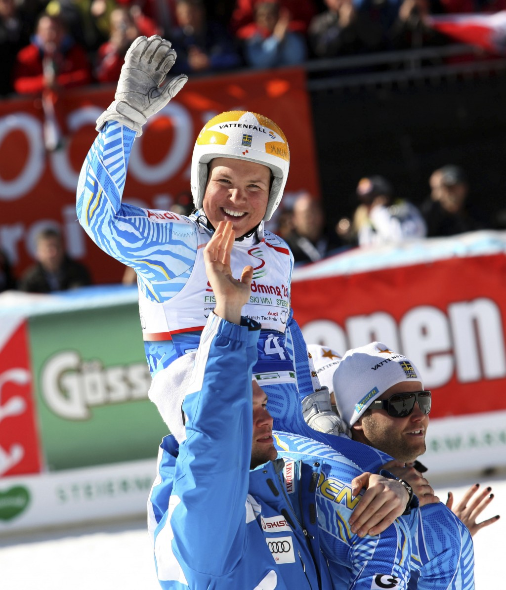 FILE - In this March 15, 2012 file photo, Sweden's Anja Paerson is carried on her teammates' shoulders after completing an alpine ski in the women's W...