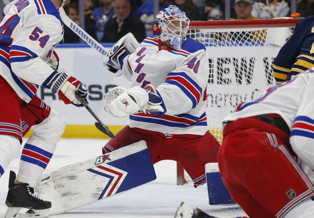 New York Rangers goalie Alexandar Georgiev (40) makes a save in traffic during the first period of an NHL hockey game against the Buffalo Sabres, Frid...