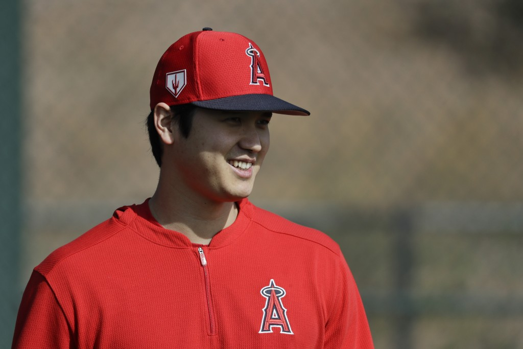 Los Angeles Angels' Shohei Ohtani, of Japan, walks on the practice field at their spring baseball training facility in Tempe, Ariz., Friday, Feb. 15, ...