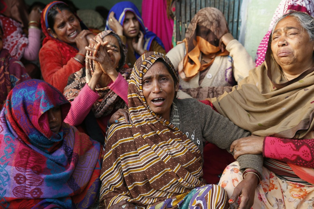 Shanti Devi, center, mother of paramilitary soldier Mahesh Yadav, who was killed in Thursday's explosion in Kashmir, mourns at her home in Tudihar, so...