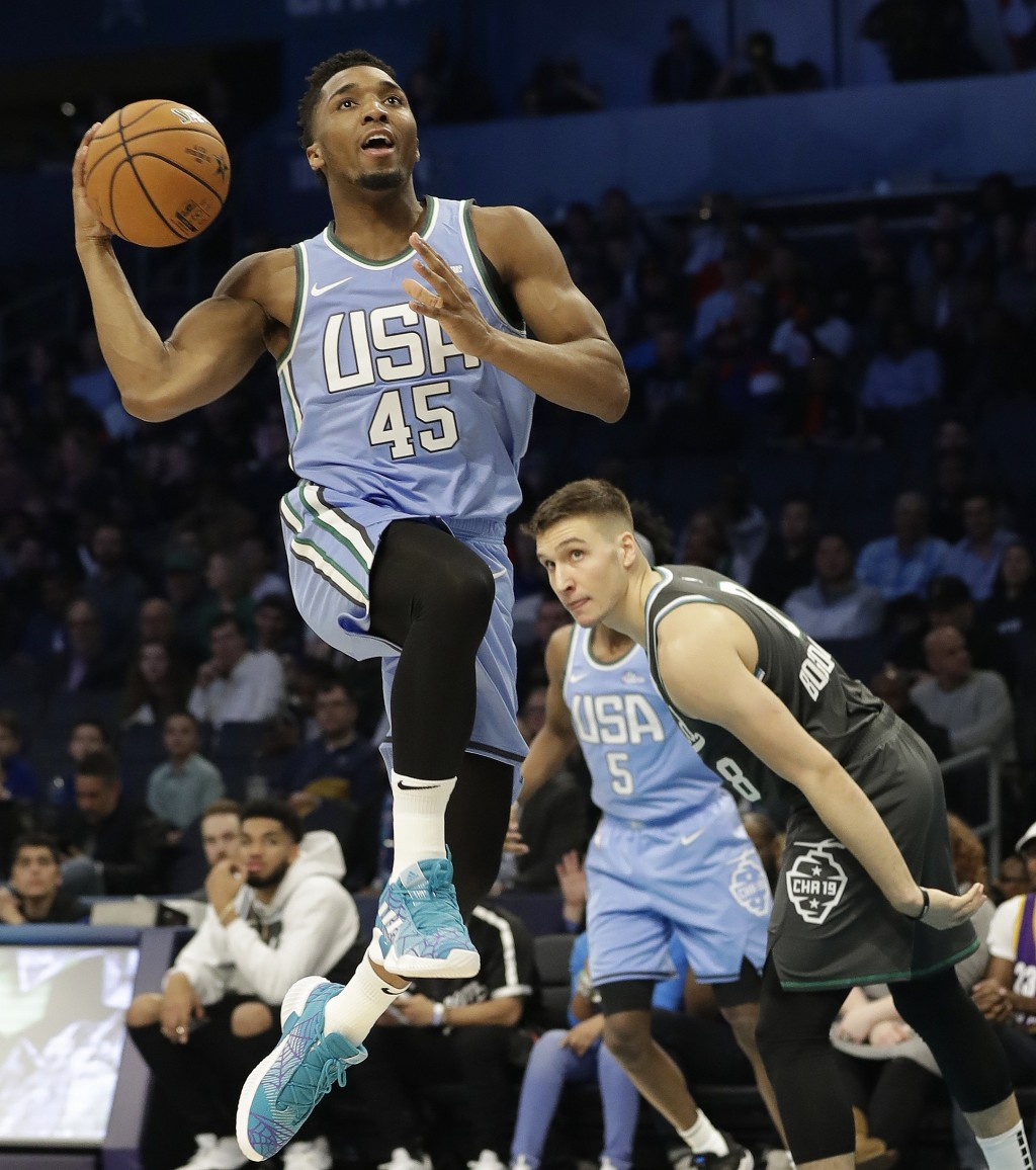 U.S. Team's Donovan Mitchell, of the Utah Jazz moves to the hoop against World Team's, Bogdan Bogdanovic, of the Sacramento Kings during the NBA All-S...